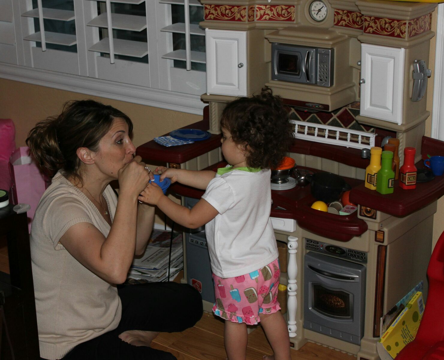 sofia playing kitchen with mom.jpg