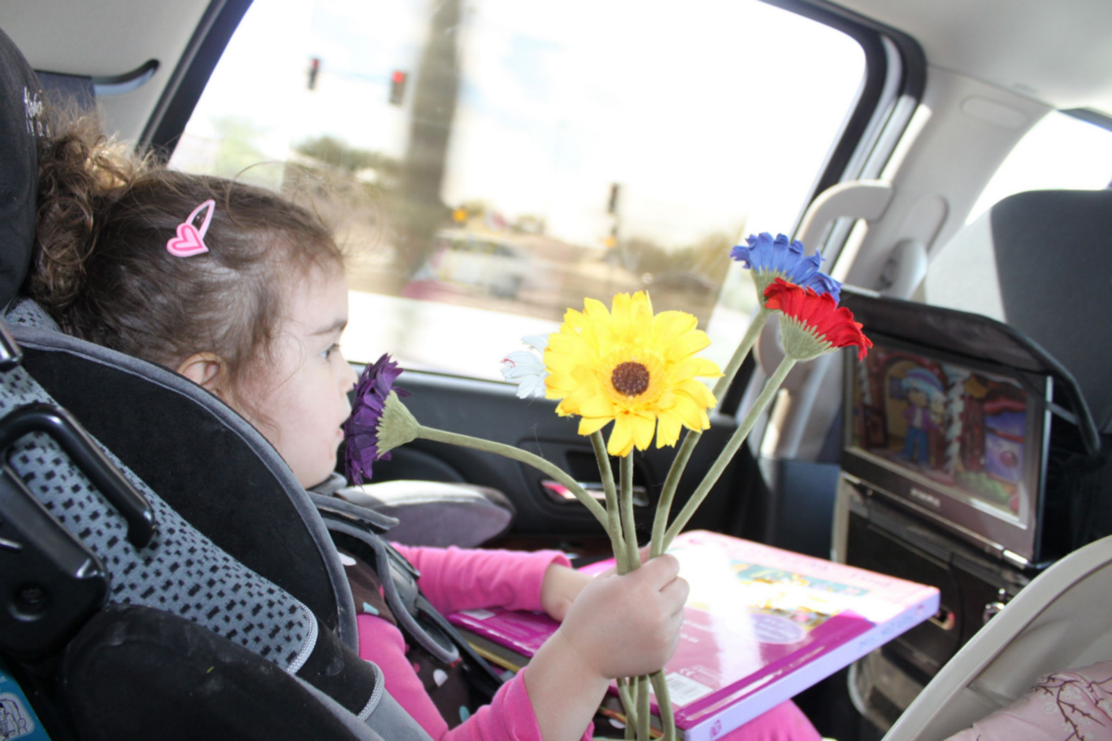 sofia drives with her flowers.jpg
